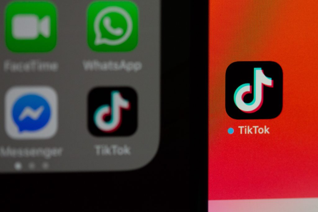 The TikTok app on the home screen of two iPhones
